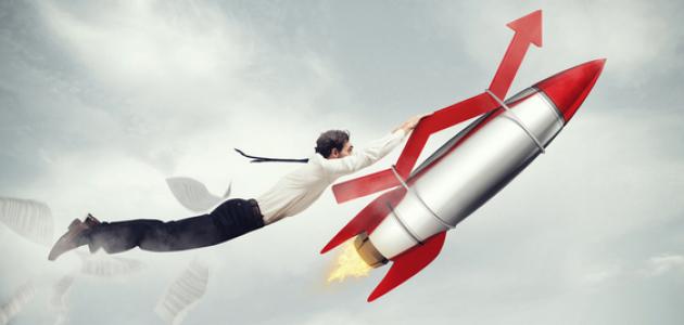 Man holding onto rocket