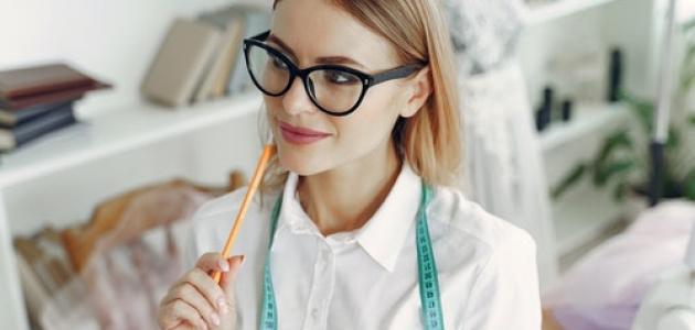 woman in white shirt wearing black framed glasses