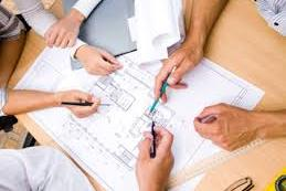People planning a project around a table