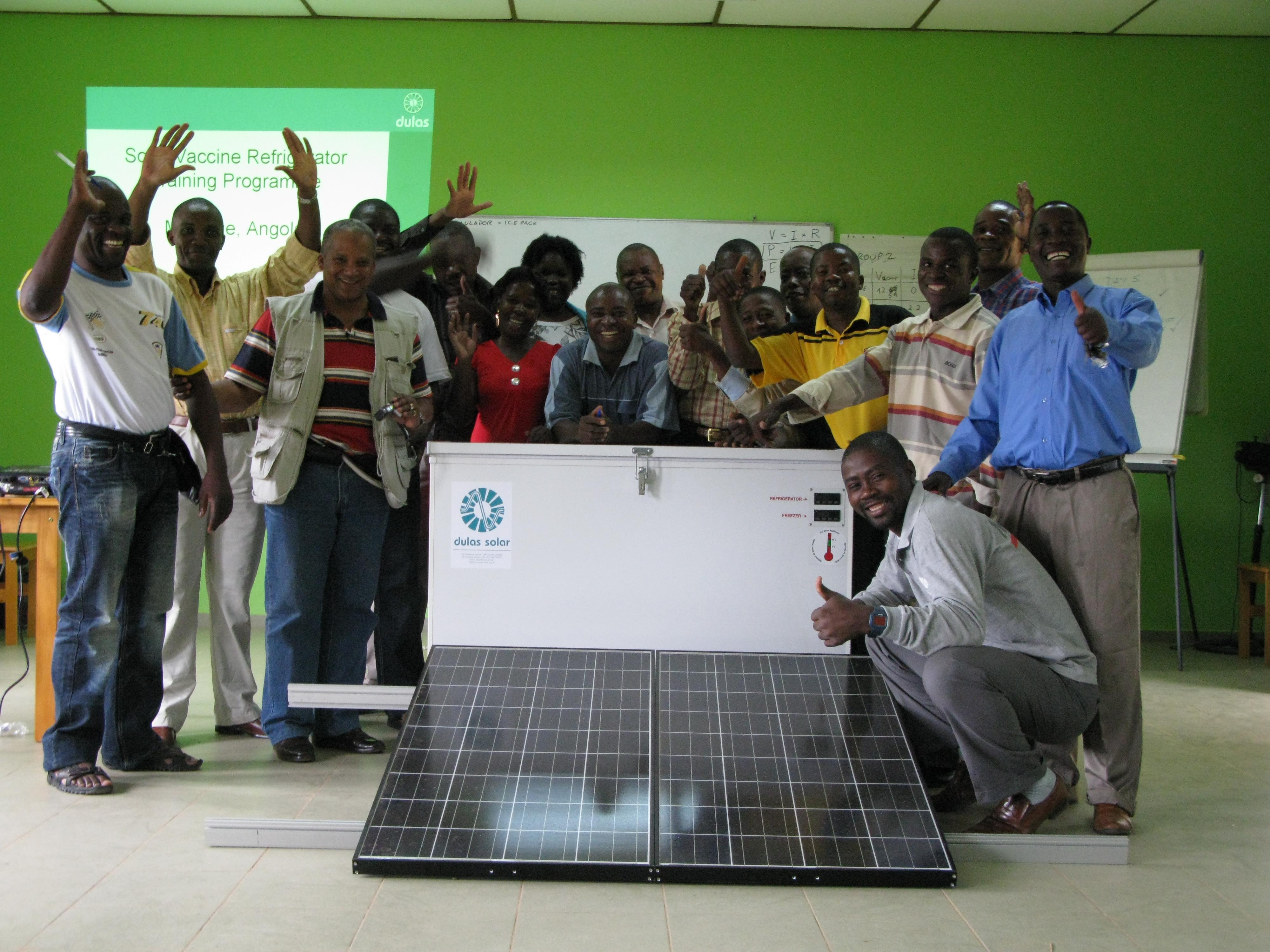 Group of people around a Solar Panel