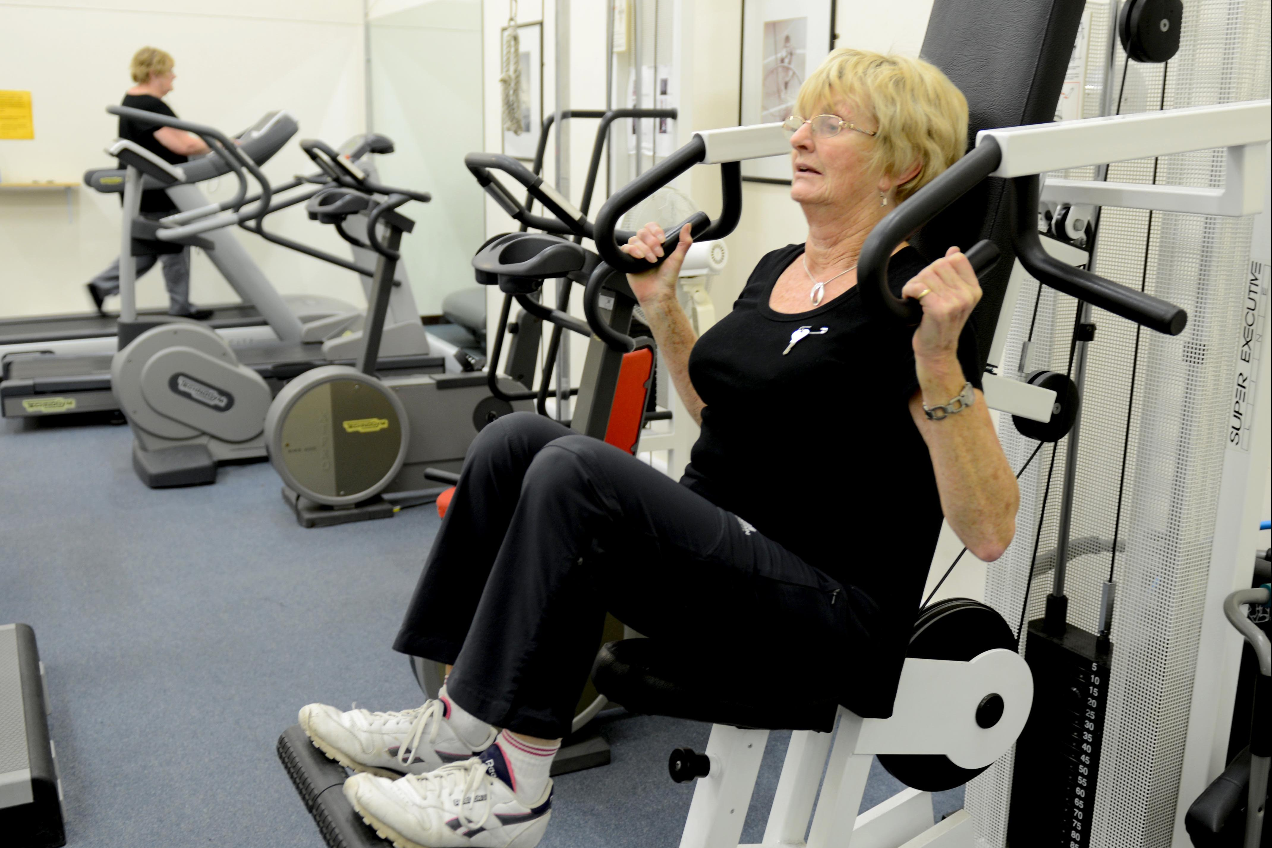 Woman using exercise machine