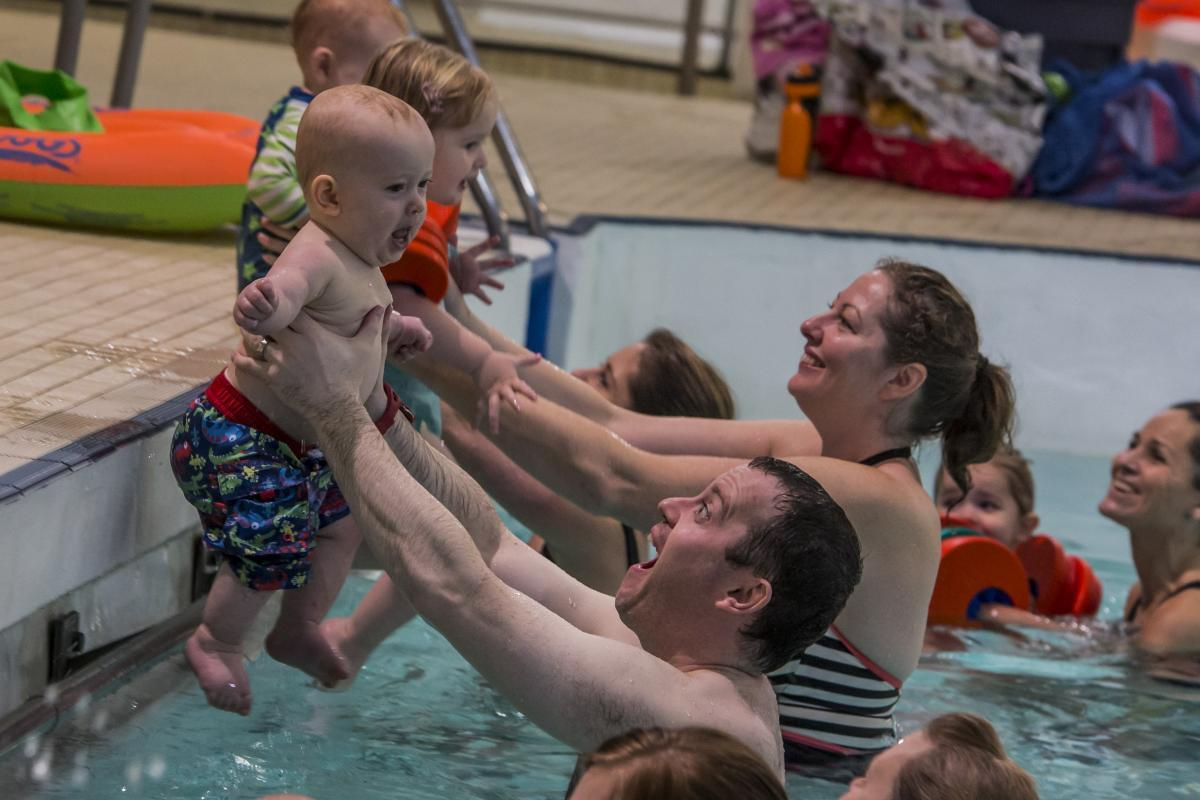 Picture of toddlers being taught how to swim