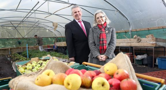 Business people in a glasshouse with produce