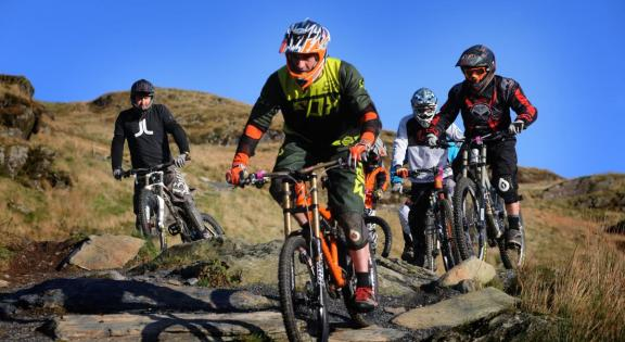 Four men on mountain bikes