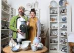 Couple stand in Pottery shop