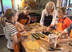 Lisa teaching children to cook