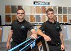 Picture of 2 men with samples of laminate flooring