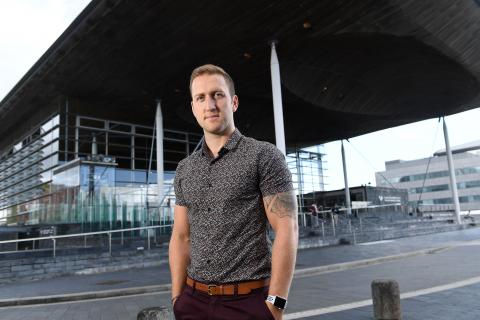 Man stood in front of Welsh Assembly